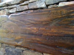 Wooden Beams Embedded in Stone